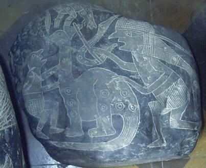 камни с рисунками динозавров.